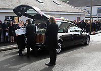 """COPY BY TOM BEDFORD<br />Pictured: Paul Black (C) carries the white coffin of his daughter Pearl after the service out of the Jerusalem Baptist Chapel in Merthyr Tydfil, Wales, UK. Friday 18 August 2017<br />Re: The funeral of a toddler who died after a parked Range Rover's brakes failed and it hit a garden wall which fell on top of her will be held today at Jerusalem Baptist Chapel in Merthyr Tydfil.<br />One year old Pearl Melody Black and her eight-month-old brother were taken to hospital after the incident in south Wales.<br />Pearl's family, father Paul who is The Voice contestant and mum Gemma have said she was """"as bright as the stars""""."""