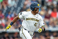 Michigan Wolverines designated hitter Jordan Nwogu (42) rounds first base against the Texas Tech Red Raiders during the first game of the NCAA College World Series on June 15, 2019 at TD Ameritrade Park in Omaha, Nebraska. Michigan defeated Texas Tech 5-3. (Andrew Woolley/Four Seam Images)