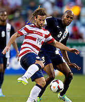PORTLAND, Ore. - July 9, 2013: Kyle Beckerman of the USA and Trevor Lennon of Belize fight for control of the ball in the first half. The US Men's National team plays the National team of Belize during the 2013 Gold Cup at at JELD-WEN Field.