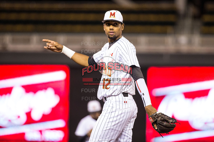 Jose Cuas (12) of the Maryland Terrapins looks on during a 2015 Big Ten Conference Tournament game between the Maryland Terrapins and Michigan State Spartans at Target Field on May 20, 2015 in Minneapolis, Minnesota. (Brace Hemmelgarn/Four Seam Images)