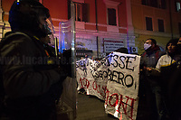 """Rome, 25/11/2020. Today, a demonstration was held in San Lorenzo district to protest against the eviction of the """"Nuovo Cinema Palazzo"""" completed by the Italian police forces in the early morning of the 25th of November. The Nuovo Cinema Palazzo was occupied the 15th of April 2011, when citizens, movements, workers of the entertainment industry reopened the former """"Palazzo Cinema"""" to prevent the opening of a casino/gambling space. The illegal occupation was intended as a hub of art, culture and politics, an open place for exchange, discussion, studies, caring and sharing. After a long and colorful march around Piazza dei Sanniti where the Nuovo Cinema Palazzo is located and blocked by the police, protesters marched in Via dei Volsci with the intention to retake the square to hold a public assembly. Here, violent clashes erupted between protesters and police officers in full riot gears.<br /> <br /> Footnotes & Links:<br /> Previous Storiy about Nuovo Cinema Palazzo: 14.04.2018 - Nuovo Cinema Palazzo's Concert: """"7 Anni di CasiNò 