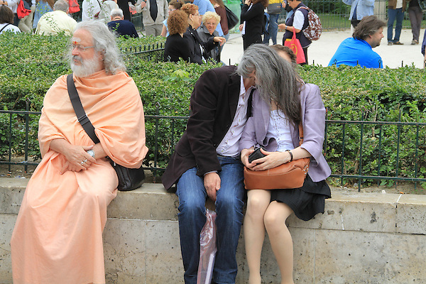 Buddhist yogi sitting with kissing couple at Notre Dame Cathedral in Paris, France. .  John offers private photo tours in Denver, Boulder and throughout Colorado, USA.  Year-round. .  John offers private photo tours in Denver, Boulder and throughout Colorado. Year-round.