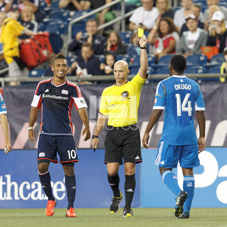 Yellow Card:  Philadelphia Union midfielder Amobi Okugo (14) from Jair Marrufo. New England Revolution forward Juan Agudelo (10)looks on. In a Major League Soccer (MLS) match, the New England Revolution (dark blue) defeated Philadelphia Union (light blue), 5-1, at Gillette Stadium on August 25, 2013.