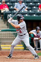 Adam Younger (8) of the Arkansas Travelers at bat during a game against the Springfield Cardinals on May 10, 2011 at Hammons Field in Springfield, Missouri.  Photo By David Welker/Four Seam Images.