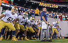 Sep. 27, 2014; The football team prepares to take the field before the game against Syracuse at MetLife Stadium. (photo by Matt Cashore)