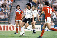 29th June 1982, Hansi Muller (GER) and Bryan Robson with Paul Mariner (both England) ; Mariner died on 9th July from a brain cancer at age 68