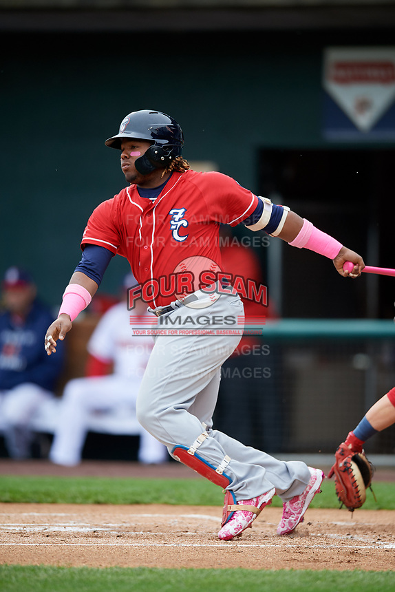 New Hampshire Fisher Cats third baseman Vladimir Guerrero Jr. (27) follows through on a swing during the first game of a doubleheader against the Harrisburg Senators on May 13, 2018 at FNB Field in Harrisburg, Pennsylvania.  New Hampshire defeated Harrisburg 6-1.  (Mike Janes/Four Seam Images)