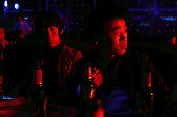 China. Jilin Province. Young men in a nightclub in the town of Yanji, close to the border with North Korea. The town is part of the Korean Autonomous Prefecture in the north-east of the country. 2011