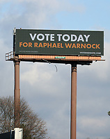 COLLEGE PARK, GA - JANUARY 5: Sign promoting votes for Raphael Warnock on I285 around the area leading to downtown Atlanta during the Georgia Senate runoff races on January 5, 2021 in College Park, Georgia. <br /> CAP/MP34<br /> ©MPI34/Capital Pictures