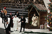 Papa Francesco al termine dell'Udienza Generale del mercoledi' in aula Paolo VI, Citta' del Vaticano, 7 dicembre 2016.<br /> Pope Francis leaves at the end of his weekly general audience in Paul VI Hall at the Vatican on December 7, 2016. <br /> UPDATE IMAGES PRESS/Isabella Bonotto<br /> <br /> STRICTLY ONLY FOR EDITORIAL USE