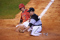 Ball State Cardinals second baseman Ryan Spaulding (5) slides into home as pitcher Zach Brenner (20) covers during a game against the Wisconsin-Milwaukee Panthers on February 26, 2016 at Chain of Lakes Stadium in Winter Haven, Florida.  Ball State defeated Wisconsin-Milwaukee 11-5.  (Mike Janes/Four Seam Images)