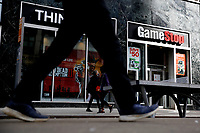 NEW YORK - NEW YORK - MARCH 23: People pass by GameStop at 6th Avenue on March 23, 2021 in New York. GameStop stocks falls more than 10% after the video game store showing  strong earnings but lower than expected. (Photo by John Smith/VIEWpress)