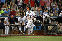 Thomas Woodruff #37 of the Virginia Cavaliers celebrates during Game 4 of the 2014 Men's College World Series between the Virginia Cavaliers and Ole Miss Rebels at TD Ameritrade Park on June 15, 2014 in Omaha, Nebraska. (Brace Hemmelgarn/Four Seam Images)