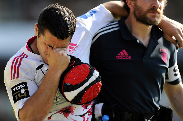 Laurent Panis of Stade Francais leaves the pitch injured during the first leg of the European Rugby Champions Cup play-off match between London Wasps and Stade Francais at Adams Park on Sunday 18th May 2014 (Photo by Rob Munro)