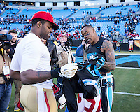The Carolina Panthers played the San Francisco 49ers at Bank of America Stadium in Charlotte, NC in the NFC divisional playoffs on January 12, 2014.  The 49ers won 23-10. Carolina Panthers wide receiver Ted Ginn (19) and San Francisco 49ers wide receiver Michael Crabtree (15) exchange jerseys after the game.