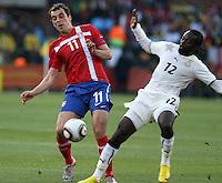 Kwadwo Asamoah (R) of Ghana and Nenad Milijas (L) of Serbia