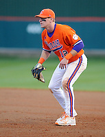 First baseman Jon McGibbon (12) of the Clemson Tigers in a game against the University of Alabama-Birmingham on Feb. 17, 2012, at Doug Kingsmore Stadium in Clemson, South Carolina. UAB won 2-1. (Tom Priddy/Four Seam Images)