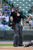 Umpire Toby Basner makes a call during a game between the Rochester Red Wings and Columbus Clippers on May 12, 2013 at Frontier Field in Rochester, New York.  Rochester defeated Columbus 5-4.  (Mike Janes/Four Seam Images)