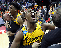 ANDREW SHURTLEFF/THE DAILY PROGRESS<br /> UMBC forward Daniel Akin (left) and UMBC forward Arkel Lamar (right) react with teammates after defeating Virginia 74-54 in the first round of the NCAA Tournament Friday in Charlotte.