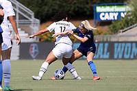 CARY, NC - SEPTEMBER 12: Denise O'Sullivan #8 of the North Carolina Courage challenges Rocky Rodriguez #11 of the Portland Thorns FC for the ball during a game between Portland Thorns FC and North Carolina Courage at Sahlen's Stadium at WakeMed Soccer Park on September 12, 2021 in Cary, North Carolina.