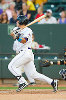 Grant Buckner (28) of the Winston-Salem Dash follows through on his swing against the Carolina Mudcats at BB&T Ballpark on July 25, 2013 in Winston-Salem, North Carolina.  The Mudcats defeated the Dash 5-4.  (Brian Westerholt/Four Seam Images)