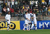 American forward Edson Buddle accepts congratualtions from teammates on his second goal of the match, this one coming in the 31st minute off a cross from defender Steve Cherundolo. The U.S. won the match, 3-1, played June 5th, in Ruimsig Stadium,  at Roodepoort, South Africa.