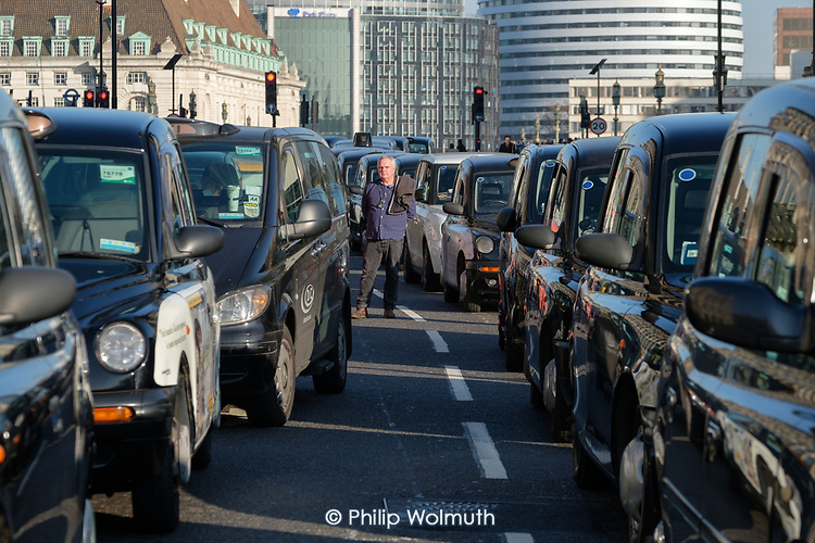 Taxi drivers blockade Pariament Square and Whitehall during a strike in protest at a TfL proposal to ban black cabs from central London bus lanes.