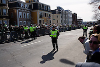 Police wait along the parade route during the St. Patrick's Day Parade in South Boston, Massachusetts.