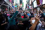 People celebrate in Times Square after former Vice President Joe Biden was declared the winner of the 2020 presidential election between U.S. President Donald Trump and Biden on November 7, 2020 in New York City.  Photograph by Michael Nagle