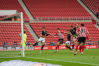 22nd May 2021; Stadium of Light, Sunderland, Tyne and Wear, England; English Football League, Playoff, Sunderland versus Lincoln City; Tom Hopper of Lincoln climbs to win the header and score for 2-1 in the 56th minute