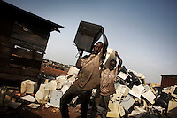 Computer monitors are broken apart to salvage metal and circuit boards at Agbogbloshie dump, which has become a dumping ground for computers and electronic waste from all over the developed world. Hundreds of tons of e-waste end up here every month. It is broken apart, and those components that can be sold on, are salvaged.