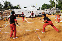 LIBERIA, Monrovia, 04/04/2007..Unit members play an evening game of badminton...© Aubrey Wade. All rights reserved.