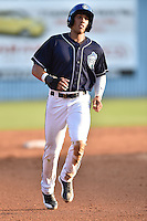 Asheville Tourists left fielder Dillon Thomas #24 runs to third during a game against the Charleston RiverDogs at McCormick Field July 26, 2014 in Asheville, North Carolina. The RiverDogs defeated the Tourists 8-7. (Tony Farlow/Four Seam Images)