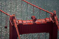 aerial photograph of the top of the south tower of the Golden Gate bridge, San Francisco, California showing the suspension cable attach points and telecommunications dishes