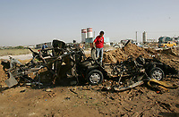 """A Palestinian boy sits next to a destroyed car after an Israeli aircraft attack in the northern Gaza May 7, 2007. An Israeli aircraft attacked a car carrying an Islamic Jihad rocket-firing squad in the Gaza Strip on Monday, wounding one militant, the group said.""""photo by Fady Adwan"""""""