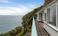 BNPS.co.uk (01202 558833)<br /> Pic: Savills/BNPS<br /> <br /> A millionaires view from the balcony at Bar Lodge. <br /> <br /> A breathtaking clifftop home that comes with its own private beach has emerged for sale for an incredible £2m.<br /> <br /> Bar Lodge, which dates back to the Edwardian period, sits in a stunning coastal position right in the mouth of the Salcombe Estuary in Devon.<br /> <br /> It is positioned high above the sea and enjoys unrivaled views right across the picturesque waterway and rocky coastline.