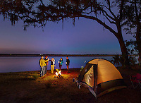 Enjoying outdoor camping, campfire, toasting, friendship along St. Mary's River