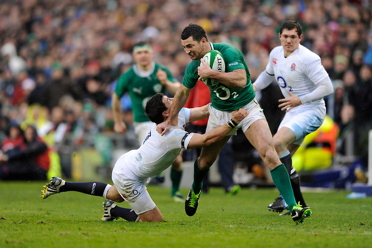 Rob Kearney of Ireland hands off Ben Youngs of England during the RBS 6 Nations match between Ireland and England at the Aviva Stadium, Dublin on Sunday 10 February 2013 (Photo by Rob Munro)