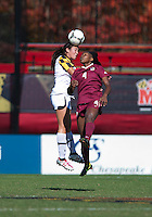 Jaima Fields (4) of Florida State goes up for a header with Erika Nelson (15) of Maryland during the game at Ludwing Field in College Park, MD.  Florida State defeated Maryland, 1-0.