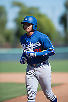 Los Angeles Dodgers catcher Diego Cartaya (91), the top prospect from the 2018 international signing period, jogs off the field during an Instructional League game against the San Diego Padres at Camelback Ranch on September 25, 2018 in Glendale, Arizona. (Zachary Lucy/Four Seam Images)