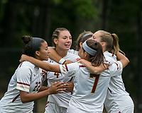 Newton, Massachusetts - September 23, 2018: NCAA Division I. Boston College (white) defeated Florida State University (garnet), 2-1, at Newton Campus Soccer Field.<br /> Jenna Bike celebrates her goal with teammates.