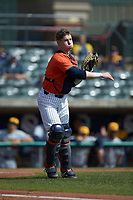 Illinois Fighting Illini catcher JacobCampbell (9) makes a throw to first base against the West Virginia Mountaineers at TicketReturn.com Field at Pelicans Ballpark on February 23, 2020 in Myrtle Beach, South Carolina. The Fighting Illini defeated the Mountaineers 2-1.  (Brian Westerholt/Four Seam Images)