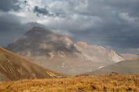 The remnants of an early snow shower play about Uncompahgre Peak's summit (14,314 feet.)