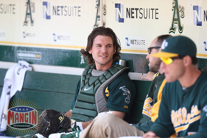 OAKLAND, CA - MAY 15:  John Jaso #5 of the Oakland Athletics sits in the dugout during the game against the Texas Rangers at O.co Coliseum on Wednesday May 15, 2013 in Oakland, California. Photo by Brad Mangin
