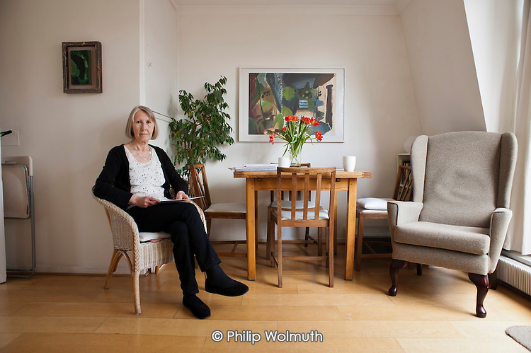 Sue Sommers, Treasurer of Drummond Street Tenants and Residents Association, in her flat in the Safeguarding Area immediately adjacent to the HS2 high-speed rail construction site at Euston station.  Residents in the area are demanding compensation for the 10 years of construction work on the same basis as affected residents in rural areas.