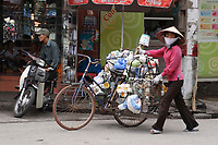 Hanoi<br /> , Vietnam - 2007 File Photo -<br /> <br /> <br /> A woman wearing a scarf to protect from pollution, near a bicycle loaded with  items for sale, in Hanoi.<br /> <br /> <br /> <br /> photo : James Wong-  Images Distribution