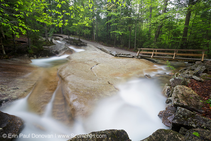 """Franconia Notch State Park - The Pemigewasset River in the area of """"The Basin"""" viewing area in Lincoln, New Hampshire USA during the spring months."""