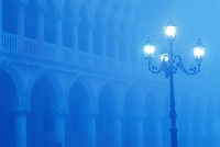 Itay, Venice, The Doge's Palace (Palazzo Ducale) Exterior facade with lamp post in fog
