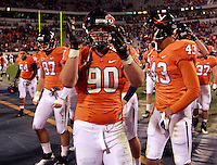 CHARLOTTESVILLE, VA- NOVEMBER 12: Defensive end Jake Snyder #90 of the Virginia Cavaliers celebrates with teammates after the game against the Duke Blue Devils on November 12, 2011 at Scott Stadium in Charlottesville, Virginia. Virginia defeated Duke 31-21. (Photo by Andrew Shurtleff/Getty Images) *** Local Caption *** Jake Snyder