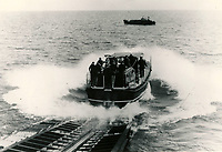 BNPS.co.uk (01202 558833)<br /> Pic: RNLI<br /> <br /> Slipway launch of a Tyne class lifeboat<br /> <br /> Splash in the Attic...<br /> <br /> A 'lost' cache of 13,000 photographs charting the history of the RNLI has been found in the attic of the charity's headquarters.<br /> <br /> Many of the black and white photos date back to the 1920s and '30s long before the terms 'health and safety' and 'risk assessment' were thought of.<br /> <br /> One image depicts a brave lifeboatman dressed in a suit and cloth cap just as the lifeboat he is on launches down a ramp into a choppy sea.<br /> <br /> Another shows the crew of another open lifeboat getting swamped by waves with only their souwesters and lifejackets to protect them.<br /> <br /> The photos have been unearthed in storage space at the RNLI HQ in Poole, Dorset, and they are now being digitised.
